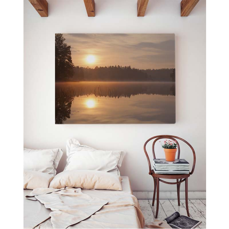 bedroom interior with canvas print of a sunrise