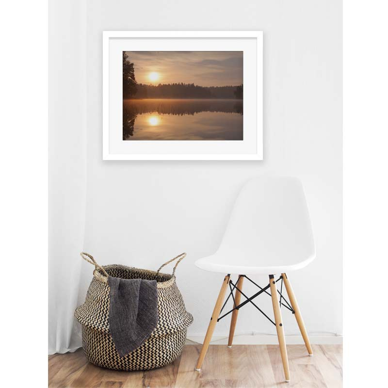 interior with basket, white chair and framed picture of sunrise